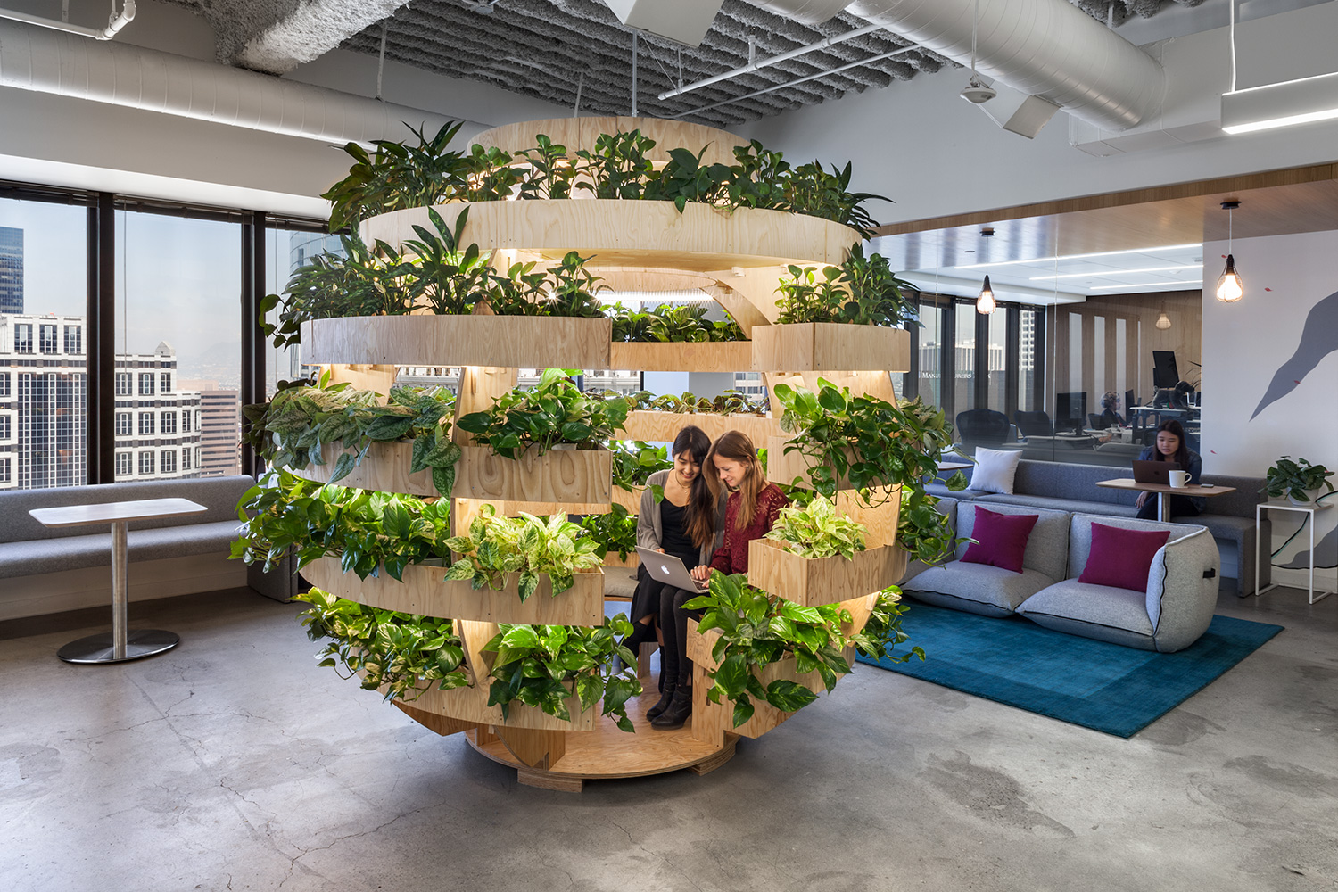 JOANY makes use of potted plants in a creative huddle space with natural light.